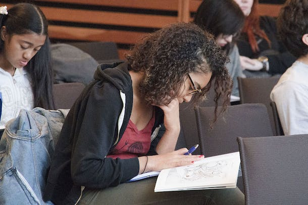 Teen writing in a notebook