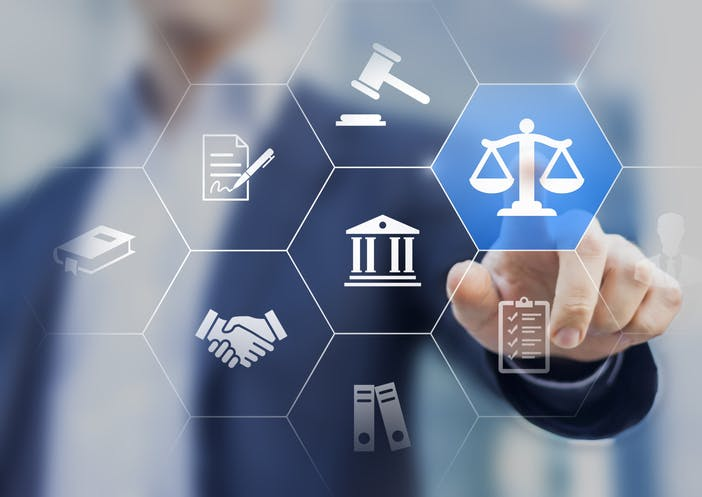 Image shows a range of icons superimposed on male figure in suit, pointing to scales of justice