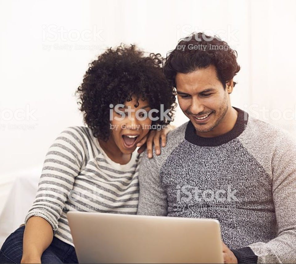 Friends reading about all the benefits you get as a Trade Nation member
