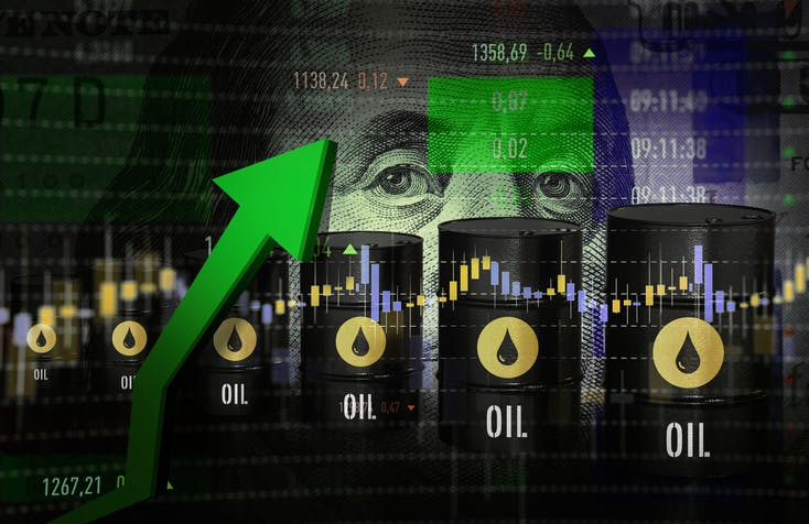 Image shows a green arrow pointing upwards against barrels of oil superimposed against a dollar bill