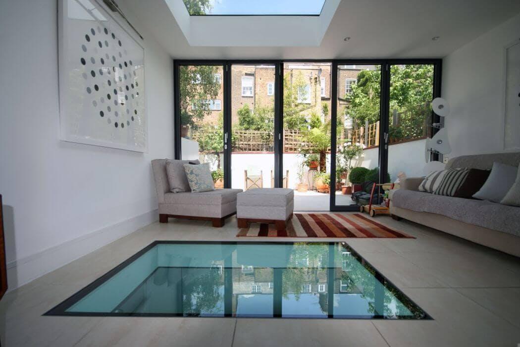 Augmenter la luminosité d'un sous sol en créant un plancher de verre au rez-de-chaussée