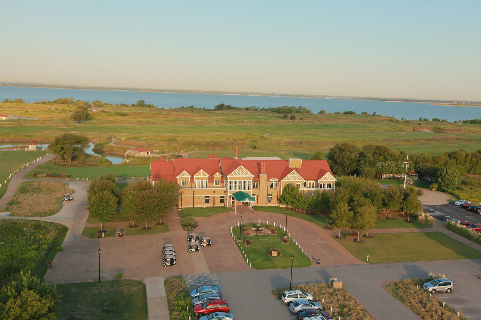 Aerial photo of the clubhouse with Lake Lewisville visible in the distance.