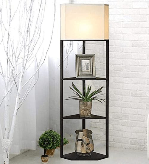 A standing lamp which incorporates shelving.