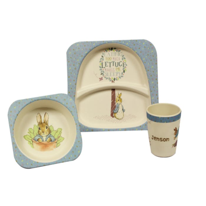 A babies dining set with Peter Rabbit drawn on it.