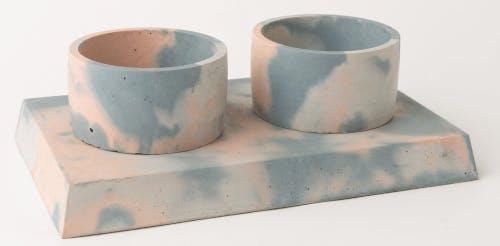 a dog bowl set made from concrete