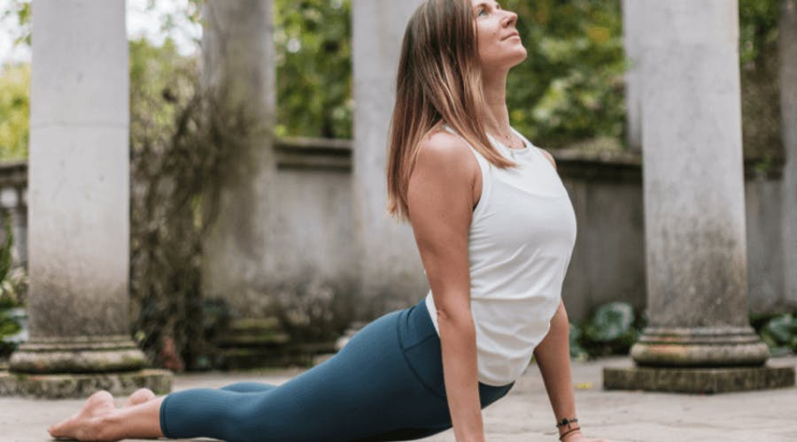 A woman in gym clothes doing a yoga pose.