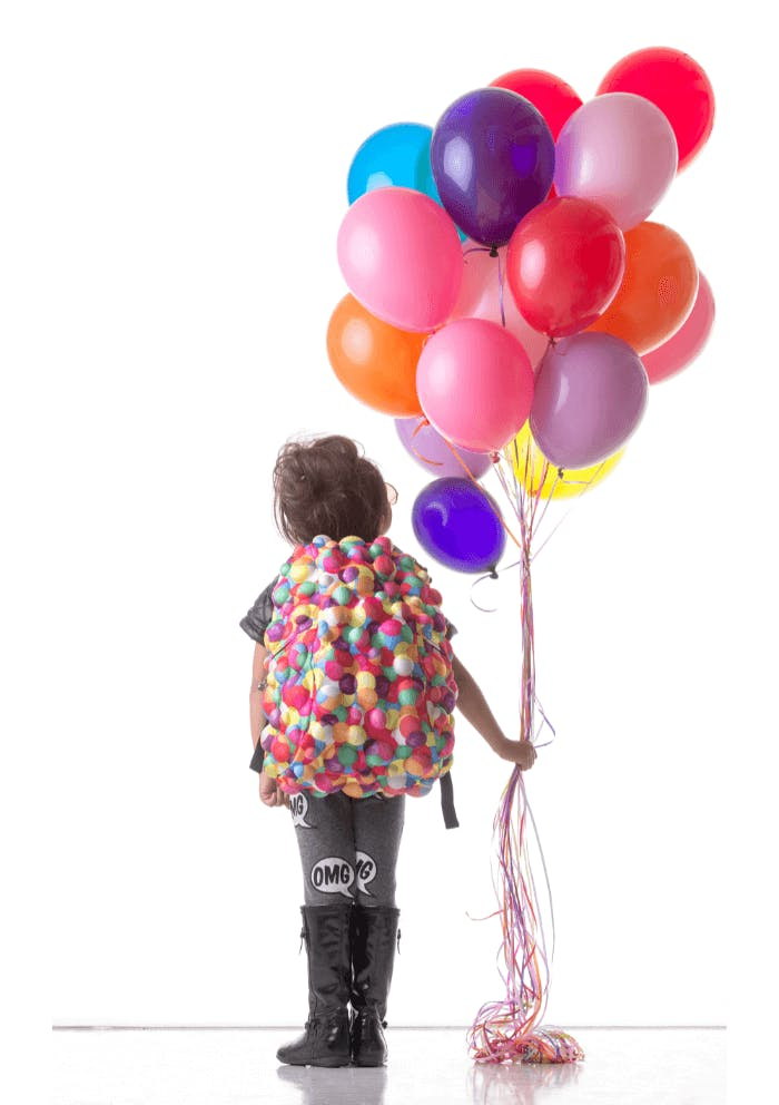 A kid holding some balloons