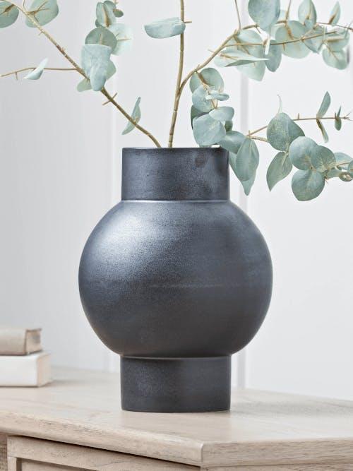 An interesting black ceramic vase.