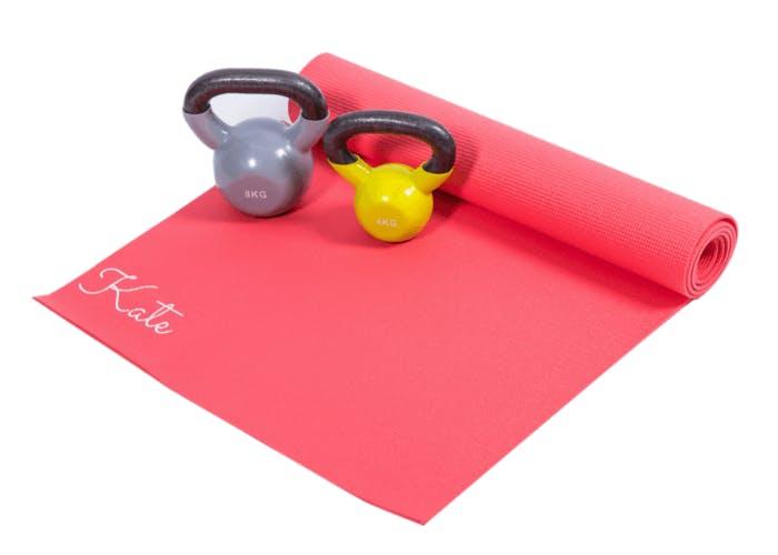 A yoga mat and kettlebells.