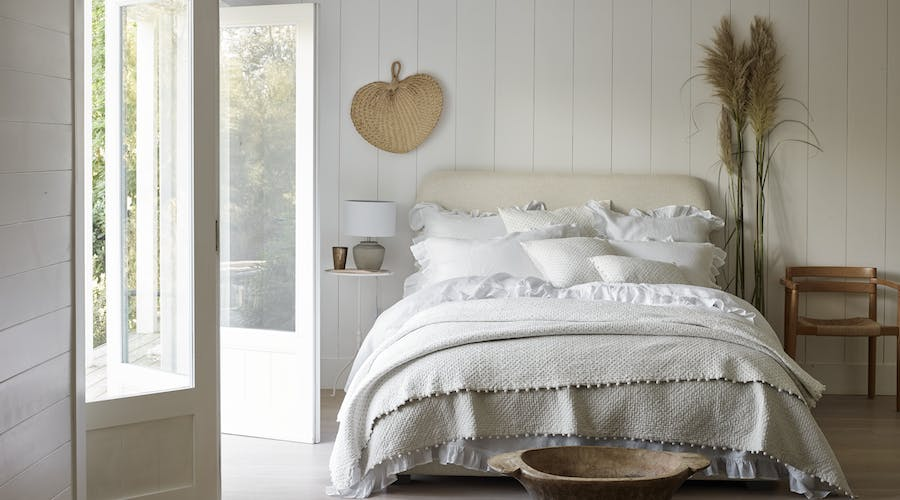 Bright bedroom with white linen.
