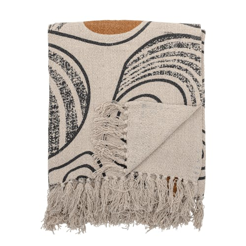 A blanket featuring Japanese style print.