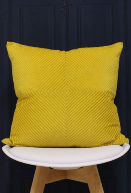 a yellow cushion