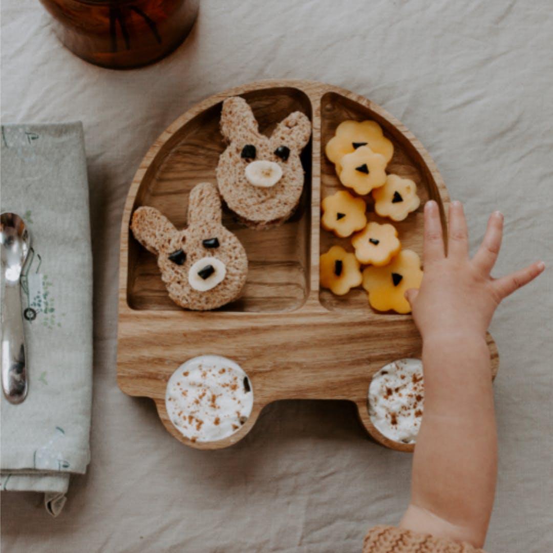 A wooden babies plate.