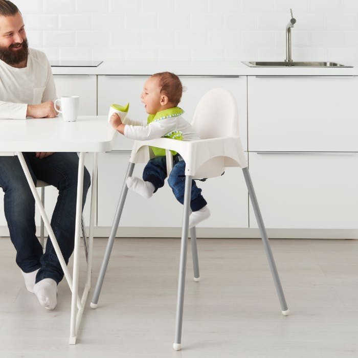 A baby in a highchair.