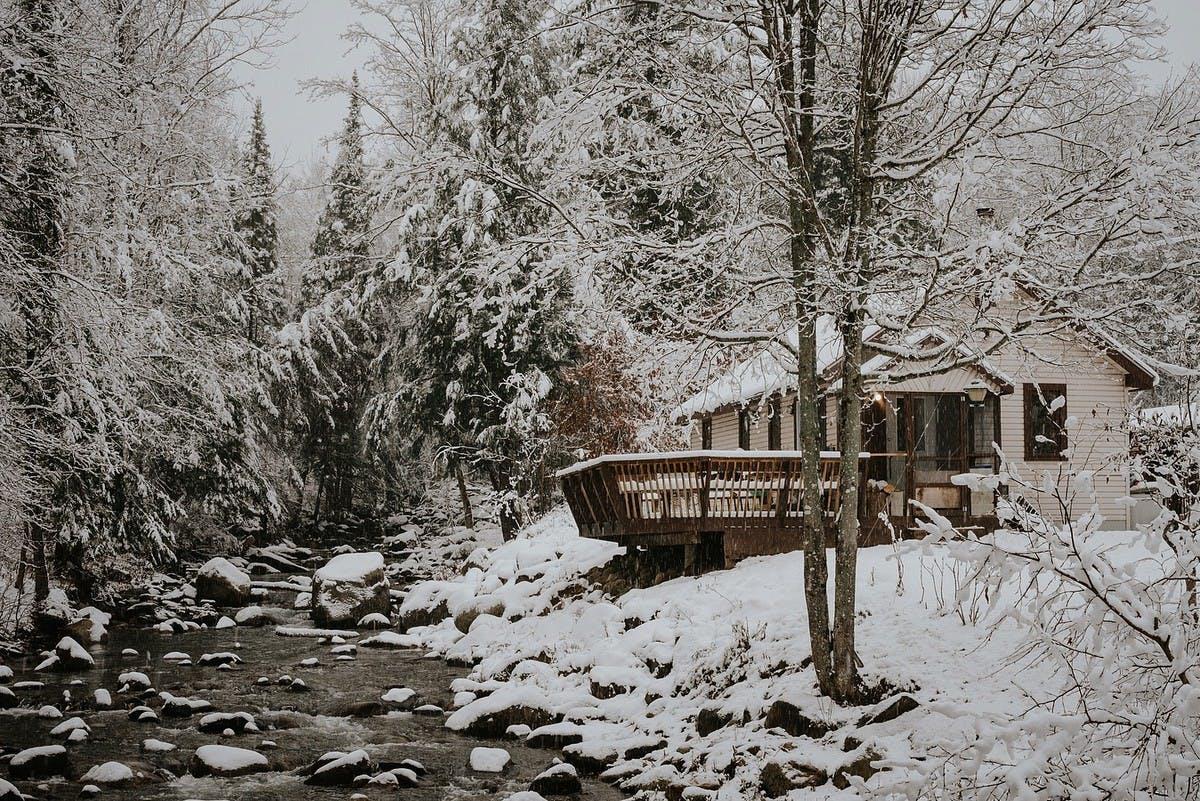 cabin in a snowy woodland scene