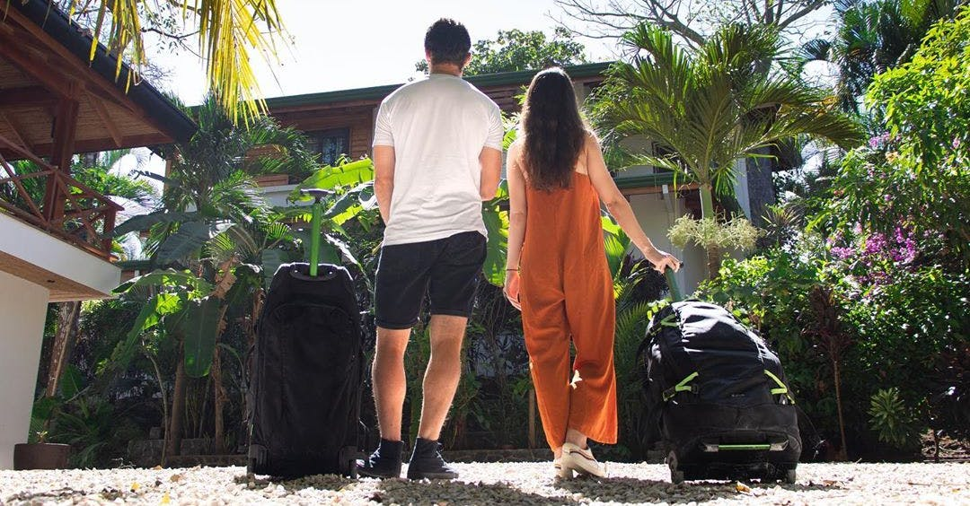 Man and woman with suitcases