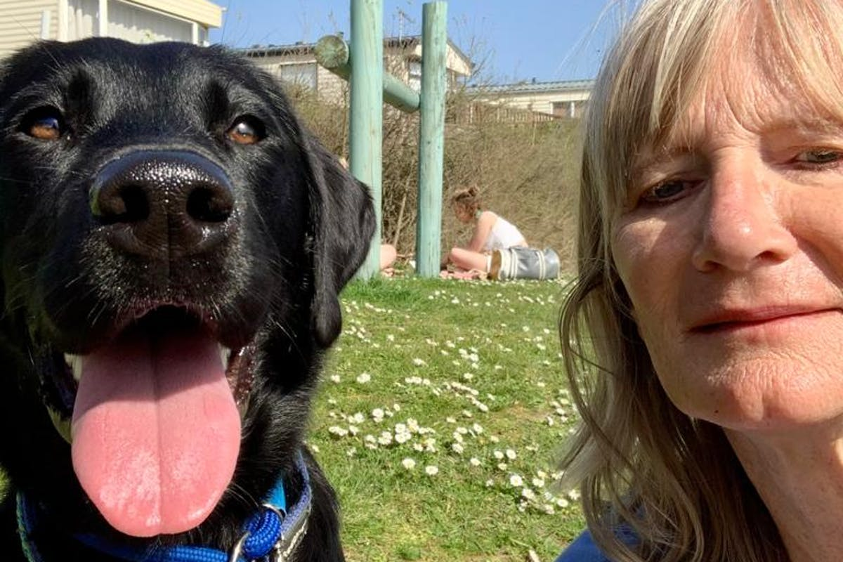 A dog and a woman taking a selfie together