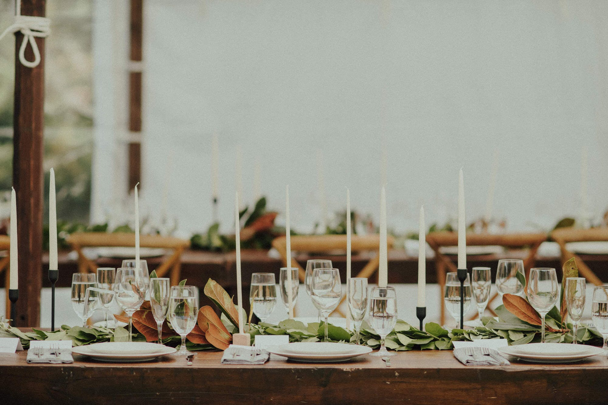 details of candles and florals on tabletop