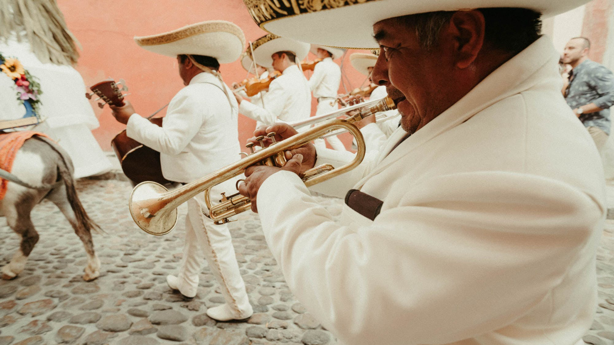mexican parade with trumpets and donkey
