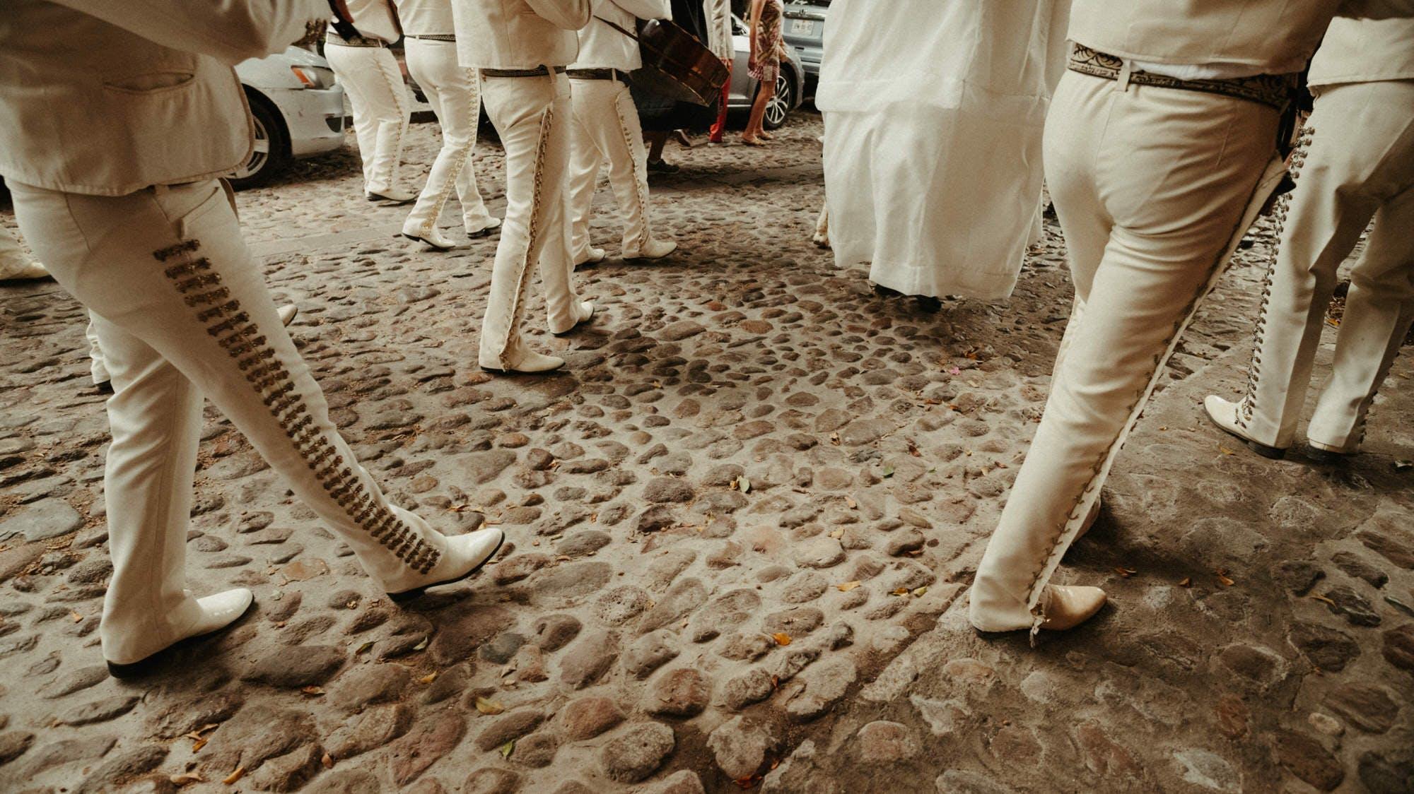 san miguel mexican parade down cobblestone streets