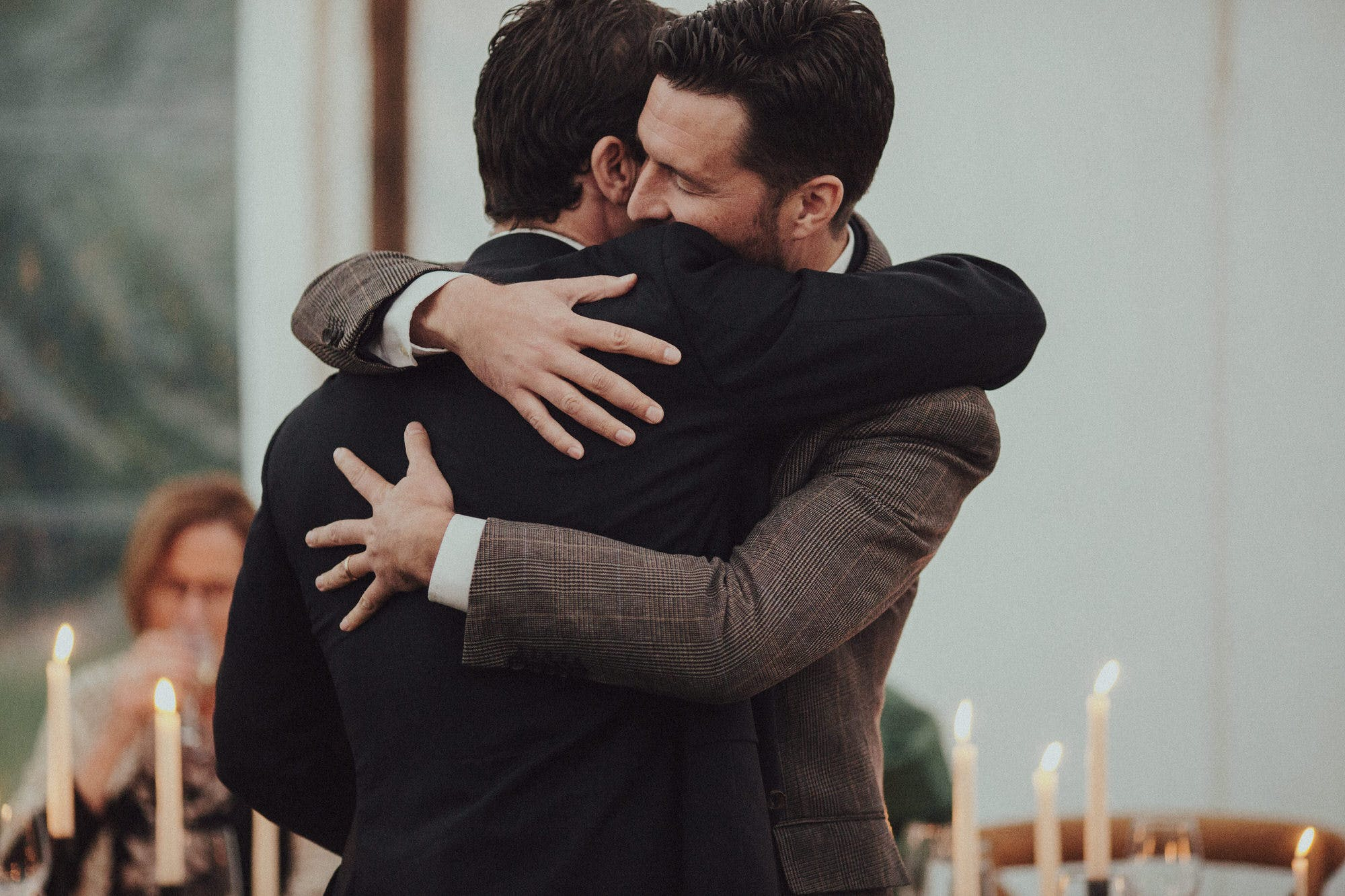 candid photos of hugs between groom and best man