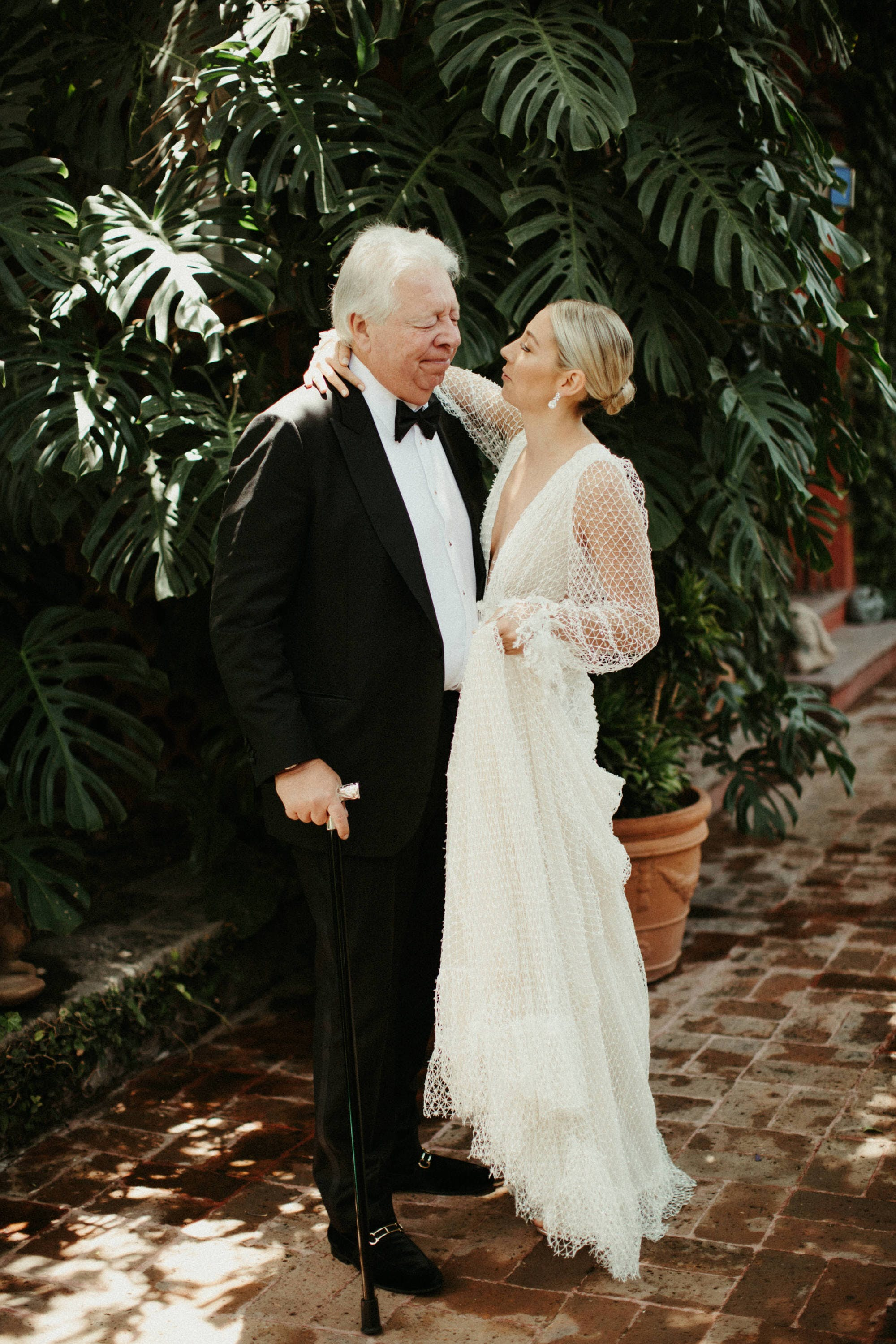 documentary style wedding photography of father daughter first look