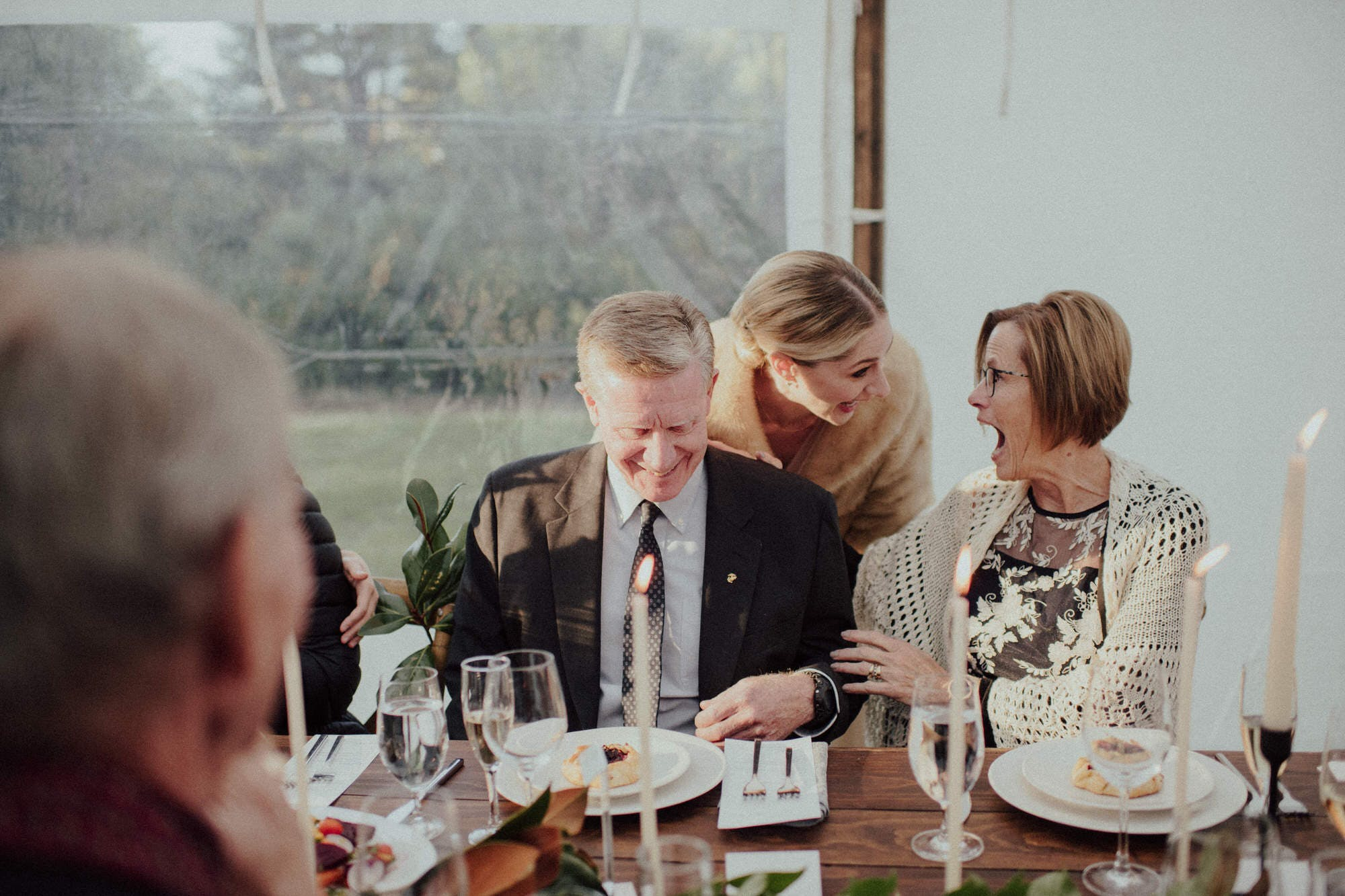 bride laughs with her parents