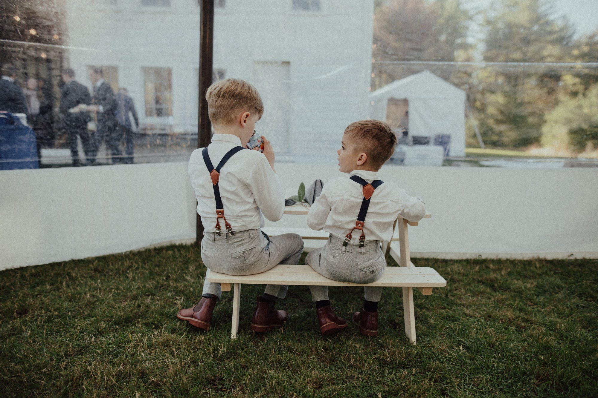 two ring bearers at their own table at a wedding