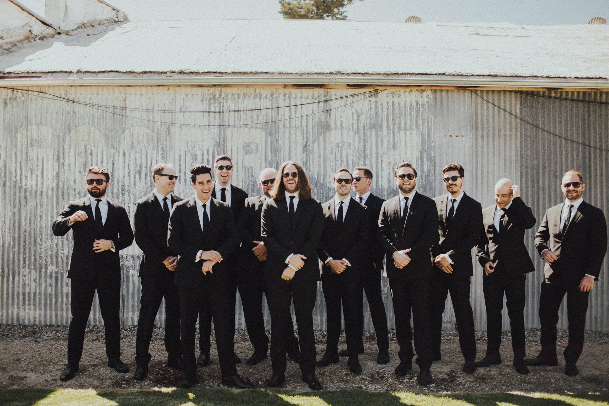 candid groomsmen pictures from los alamos