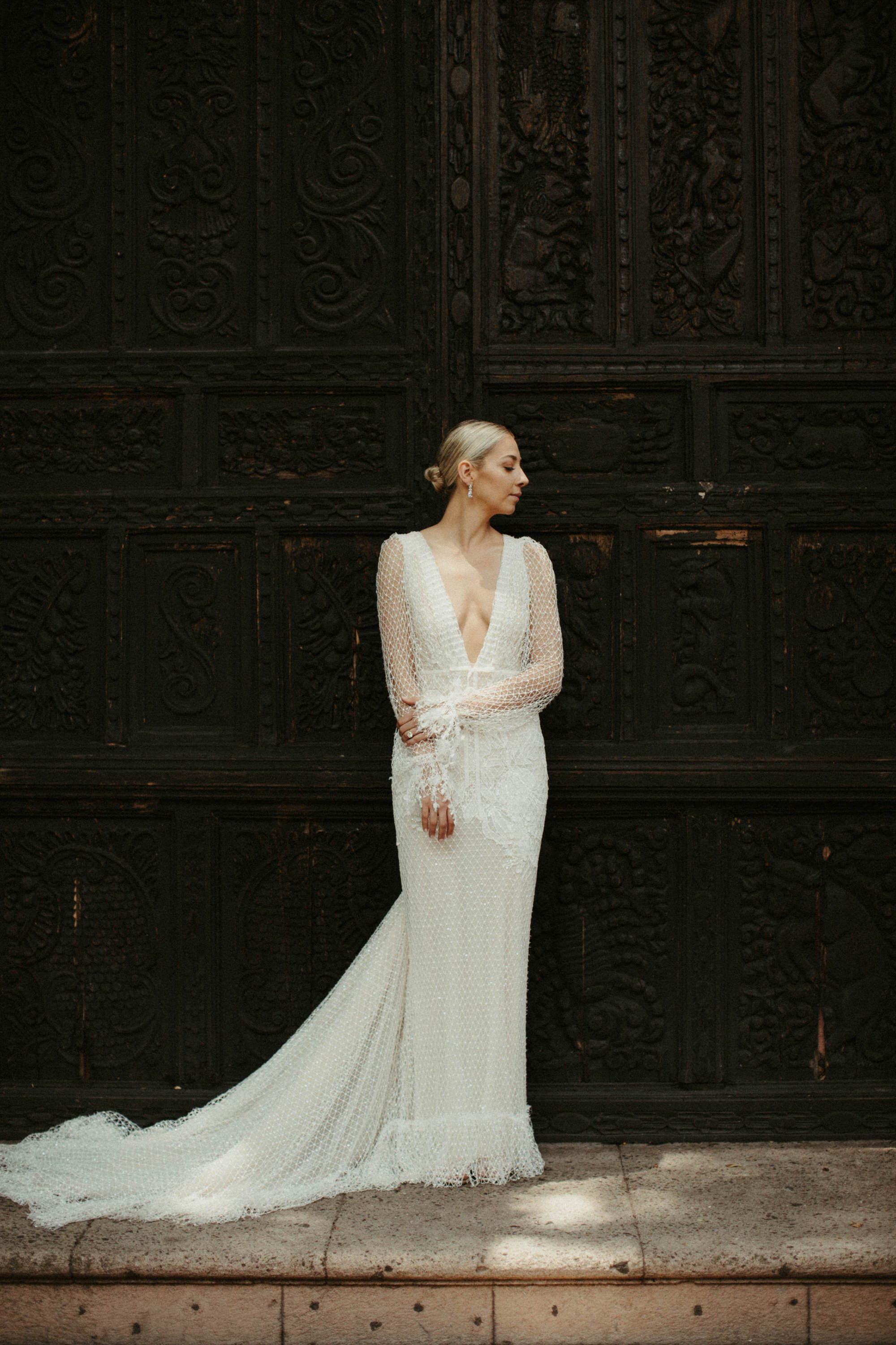 bridal portraits in front of old big black door