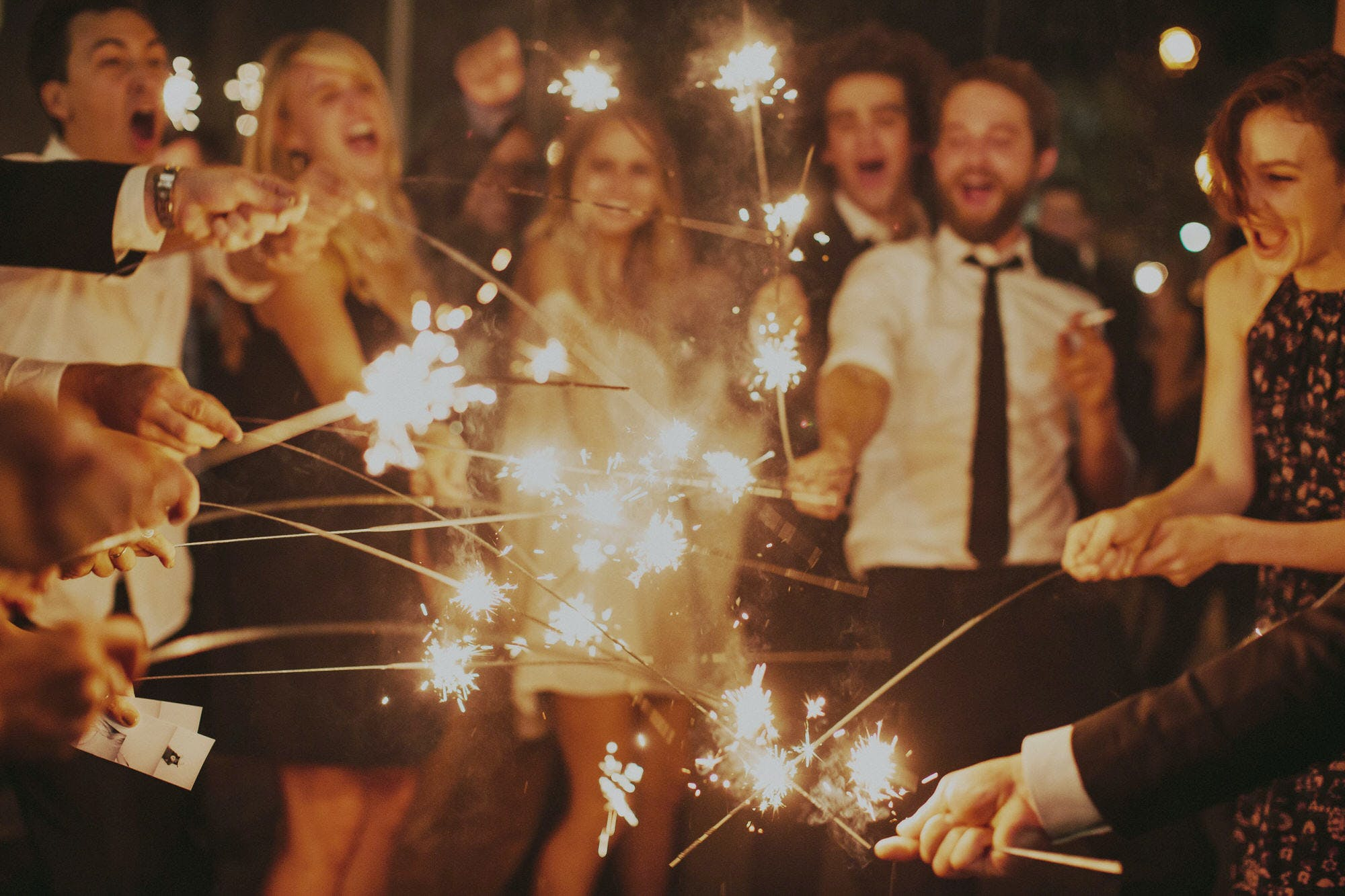 wedding guests with sparklers