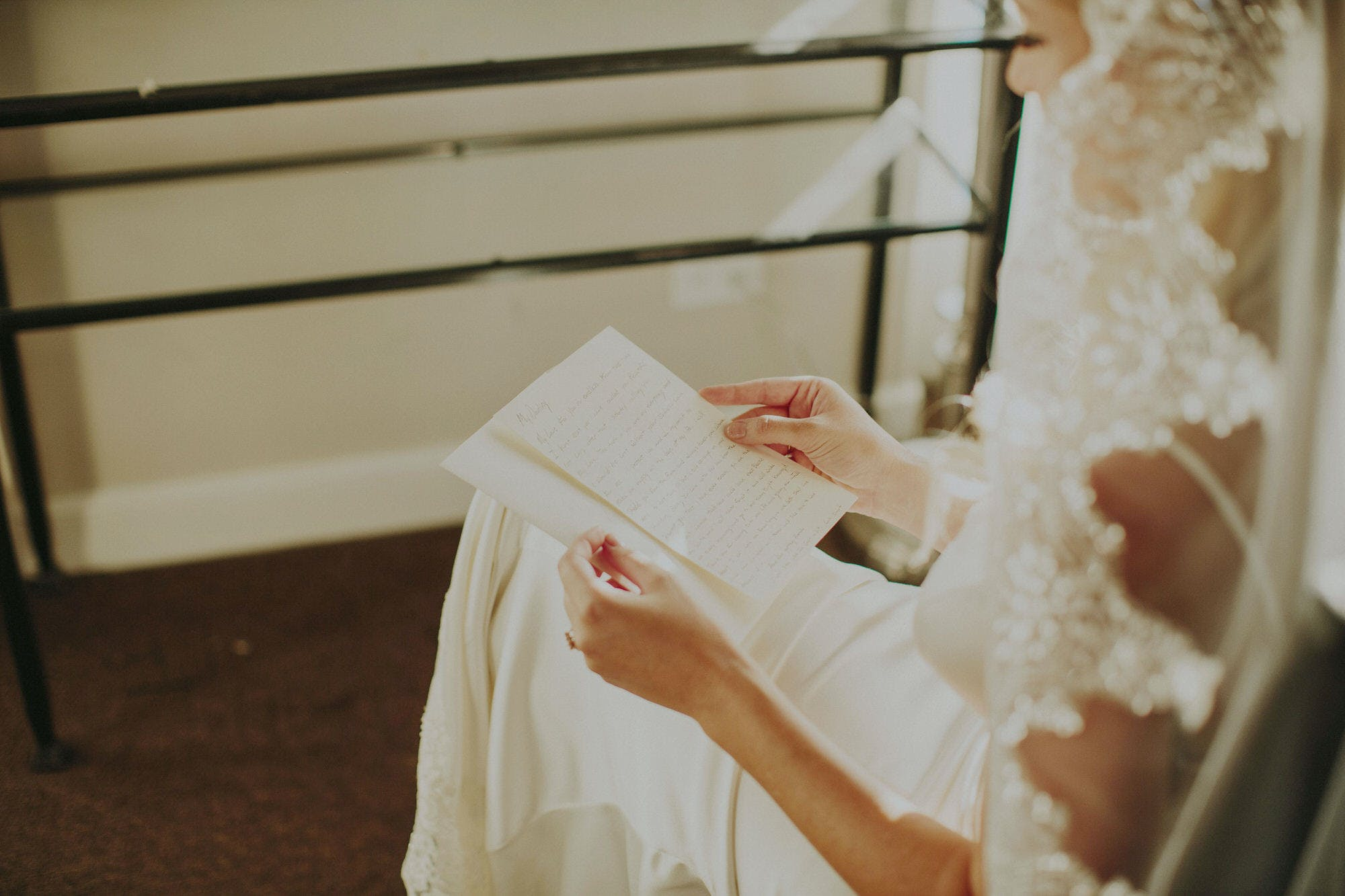 bride reading a note from her husband