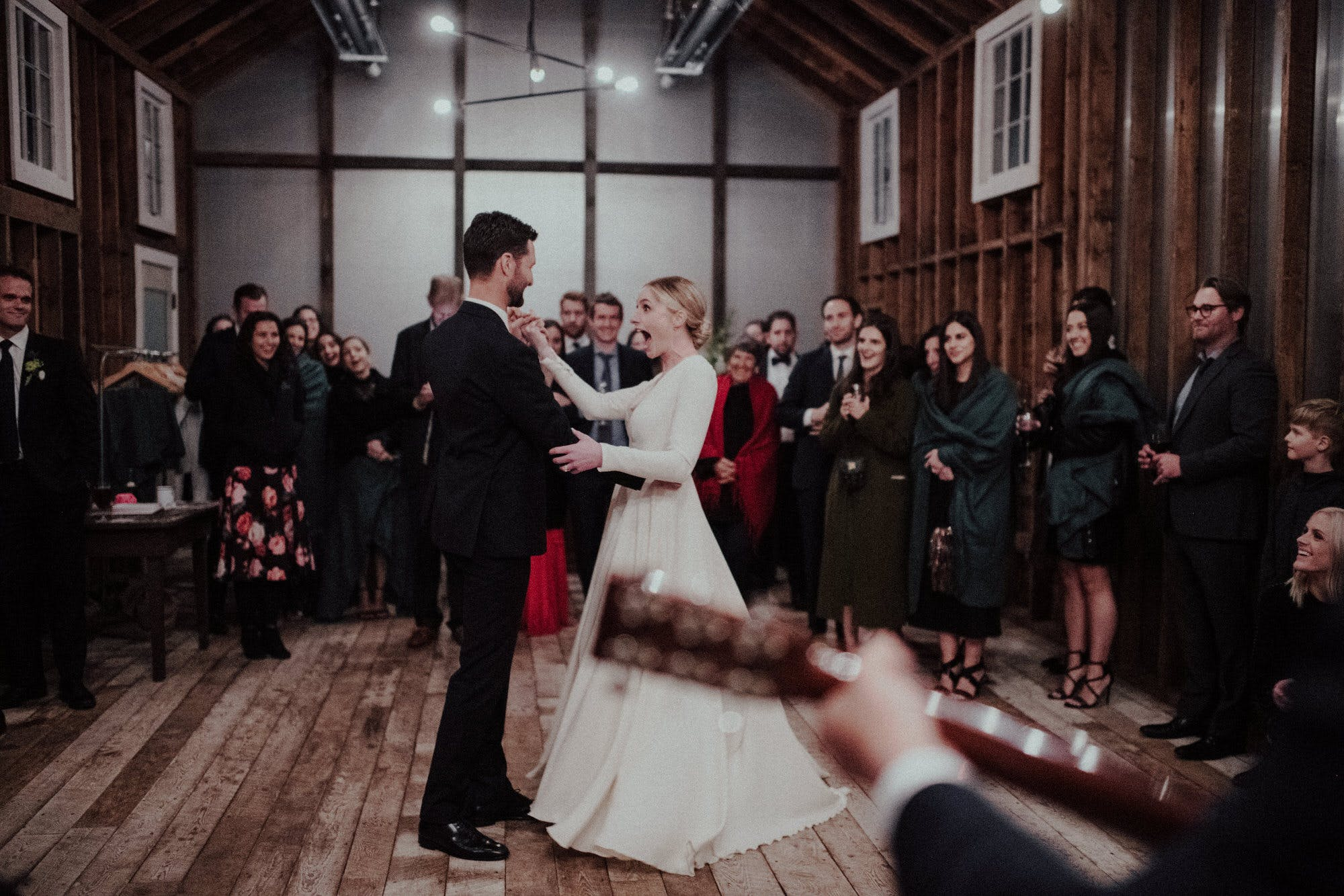 first dance in the barn at floating farmhouse