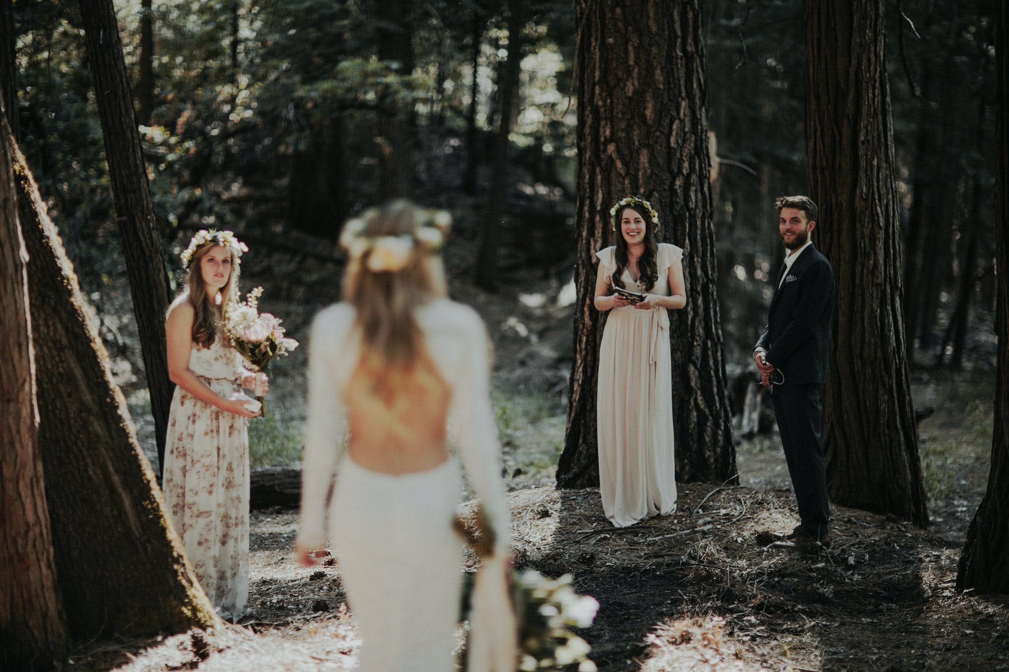 bride walking down the aisle at intimate elopement in yosemite