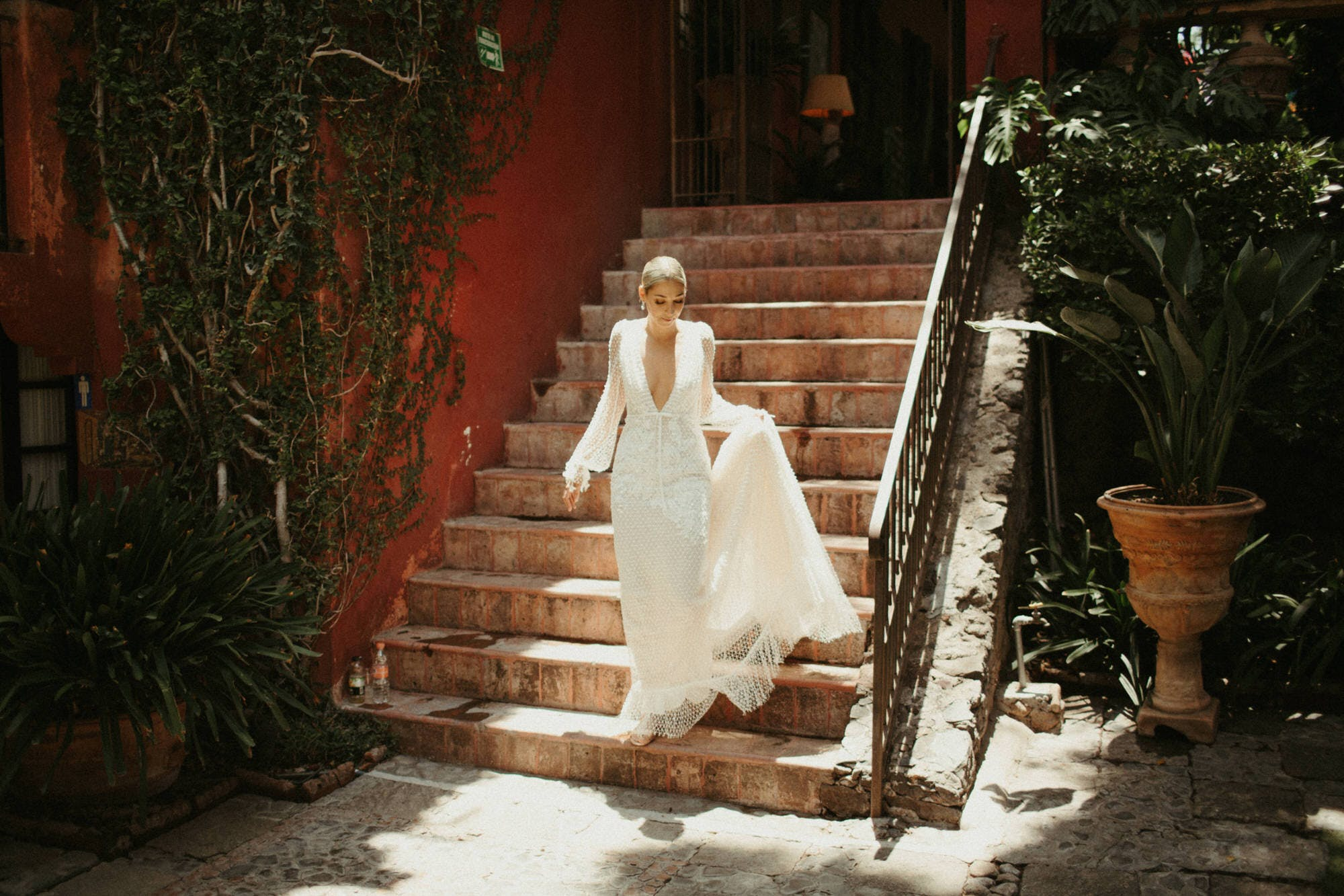bride walking down stairs in san miguel de allende