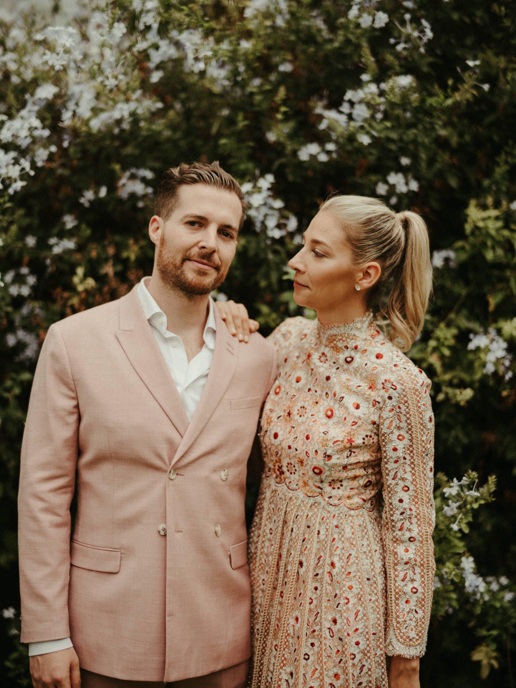 groom wearing pink jacket