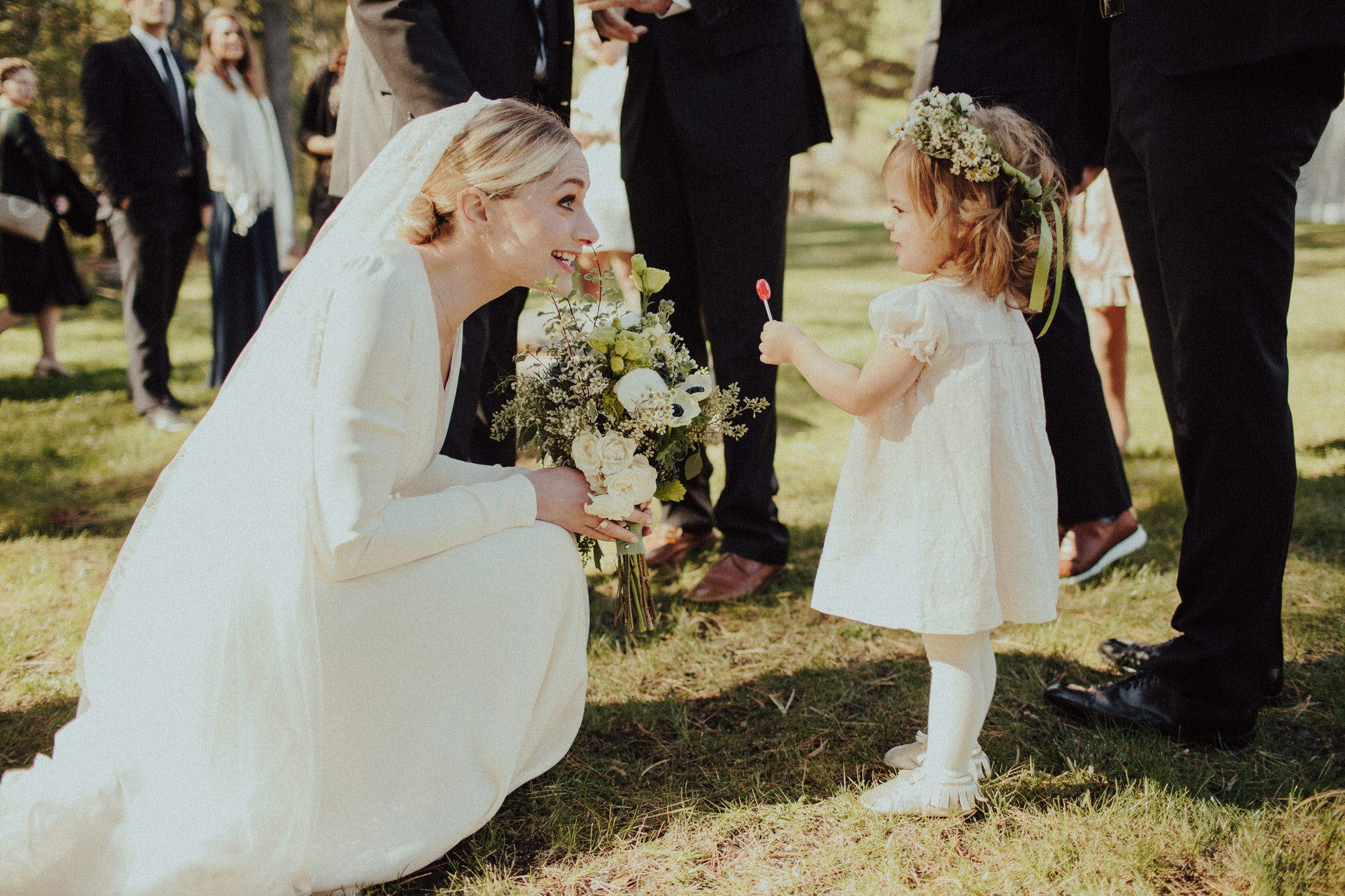 candid wedding shot of bride and flower girl