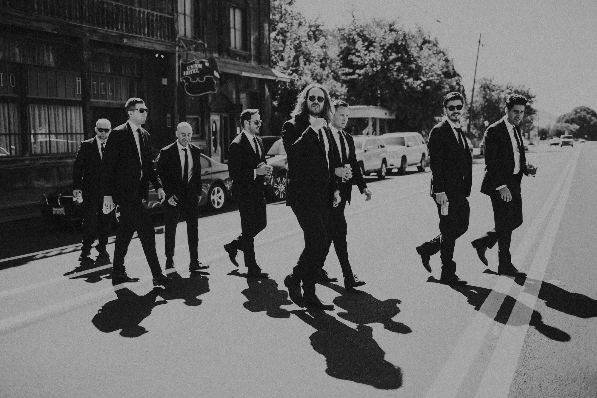 rad groomsmen pictures crossing the street
