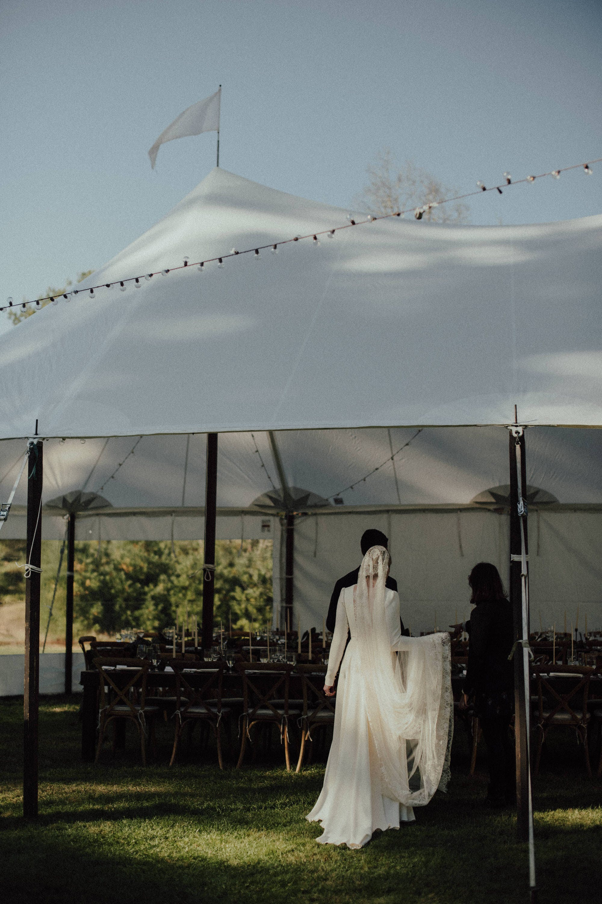 tent with flag wedding reception space
