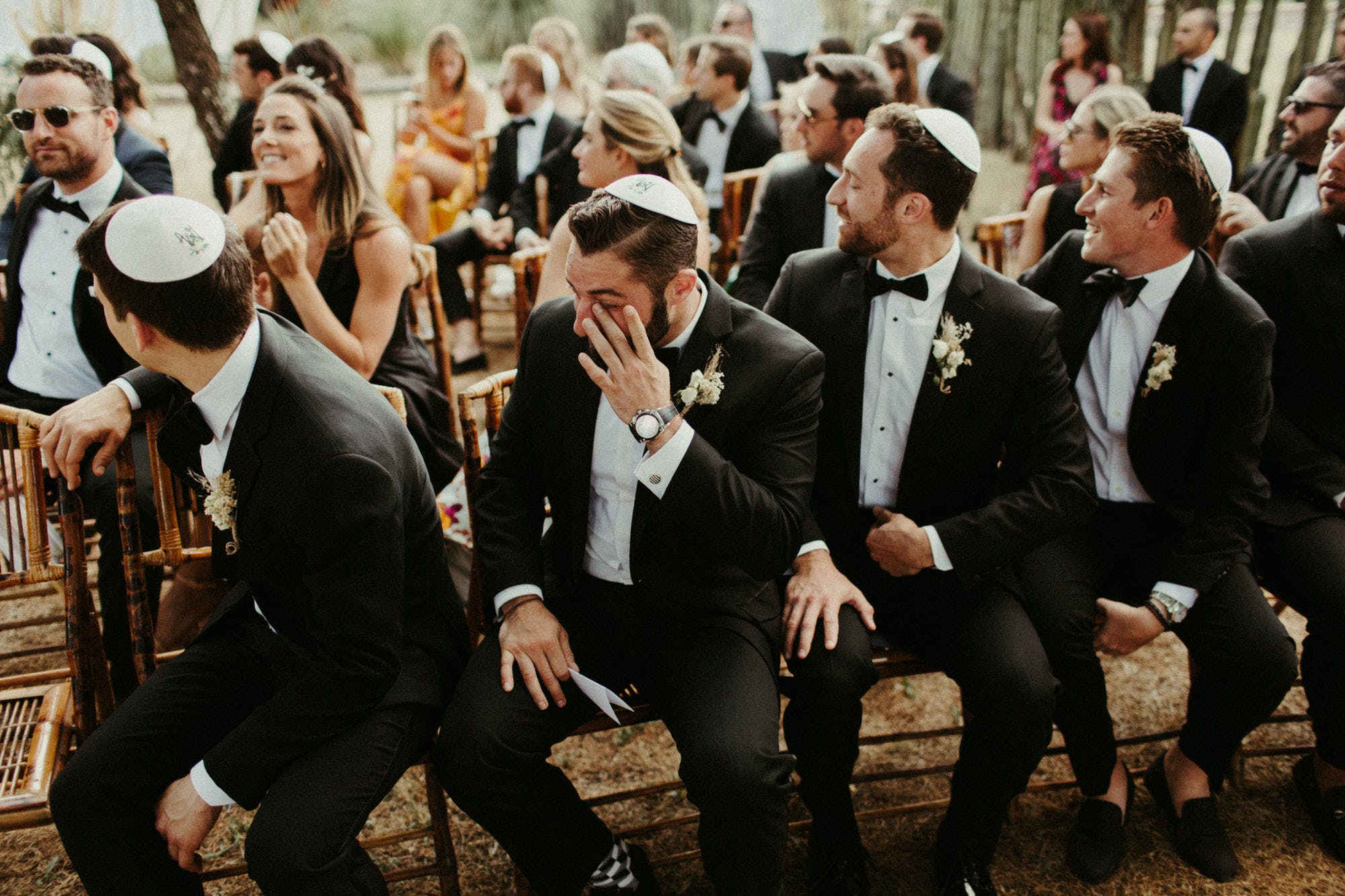 groomsmen crying watching sister walk down the aisle
