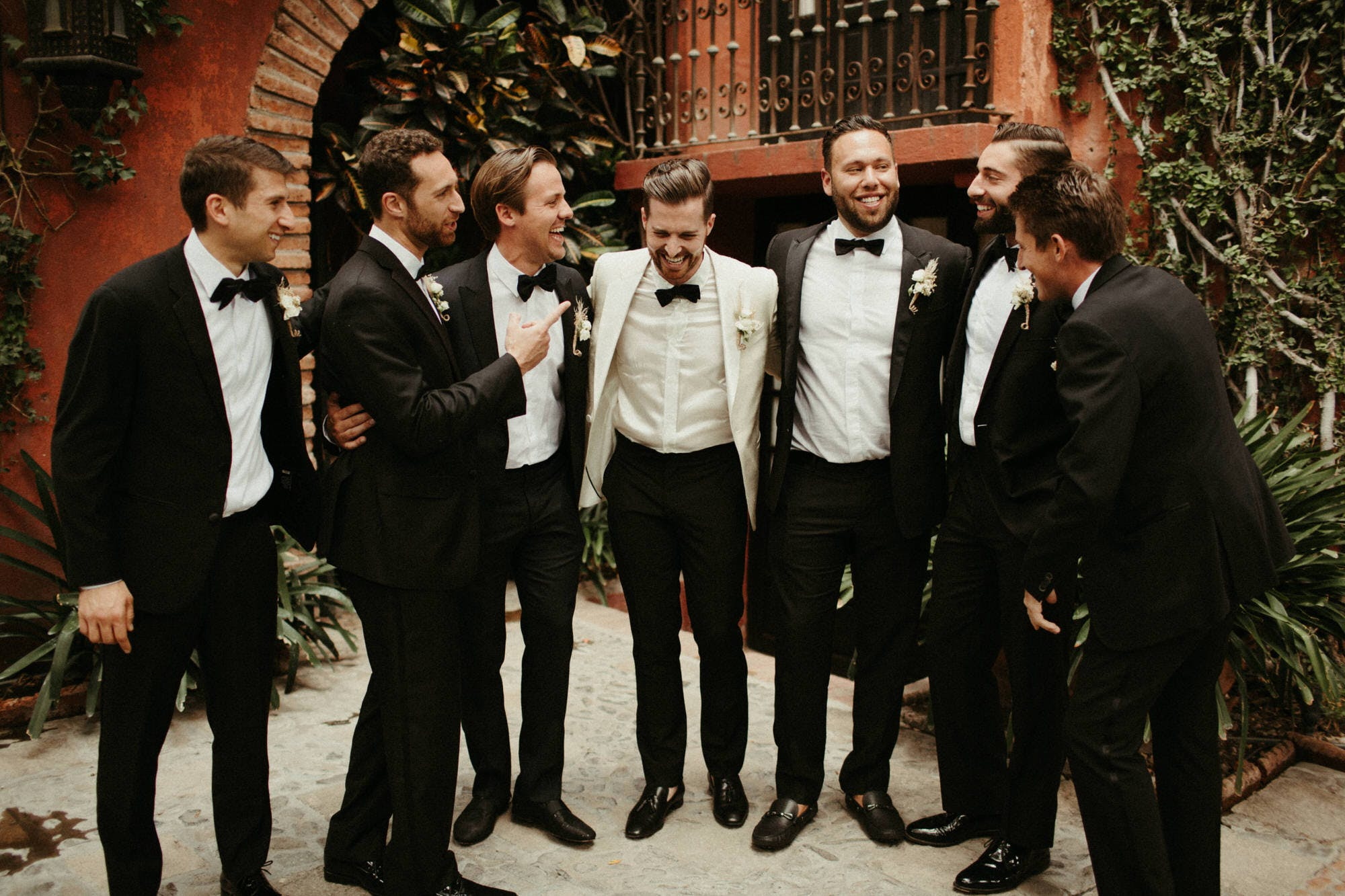 groomsmen hanging out at casa hyder in san miguel de allende mexico