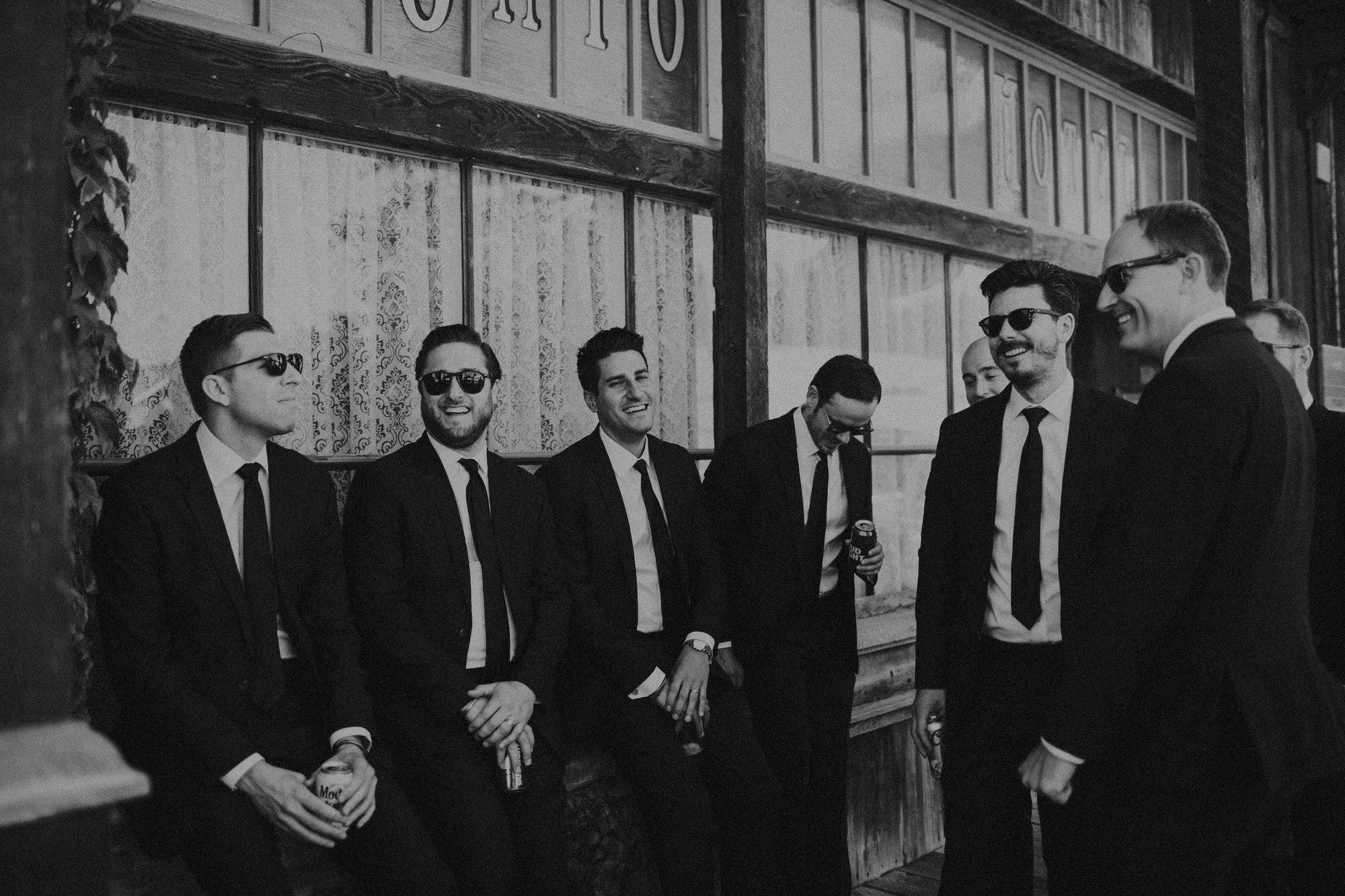 black and white candid groomsmen portraits