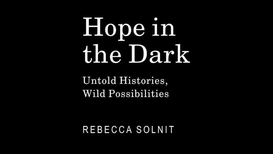 "Cover of the book ""Hope in the Dark"" by Rebecca Solnit."