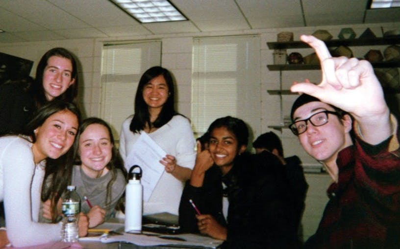 Sophie Chen with her students prior to the pandemic