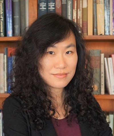 Priscilla Liu standing in front of bookshelf