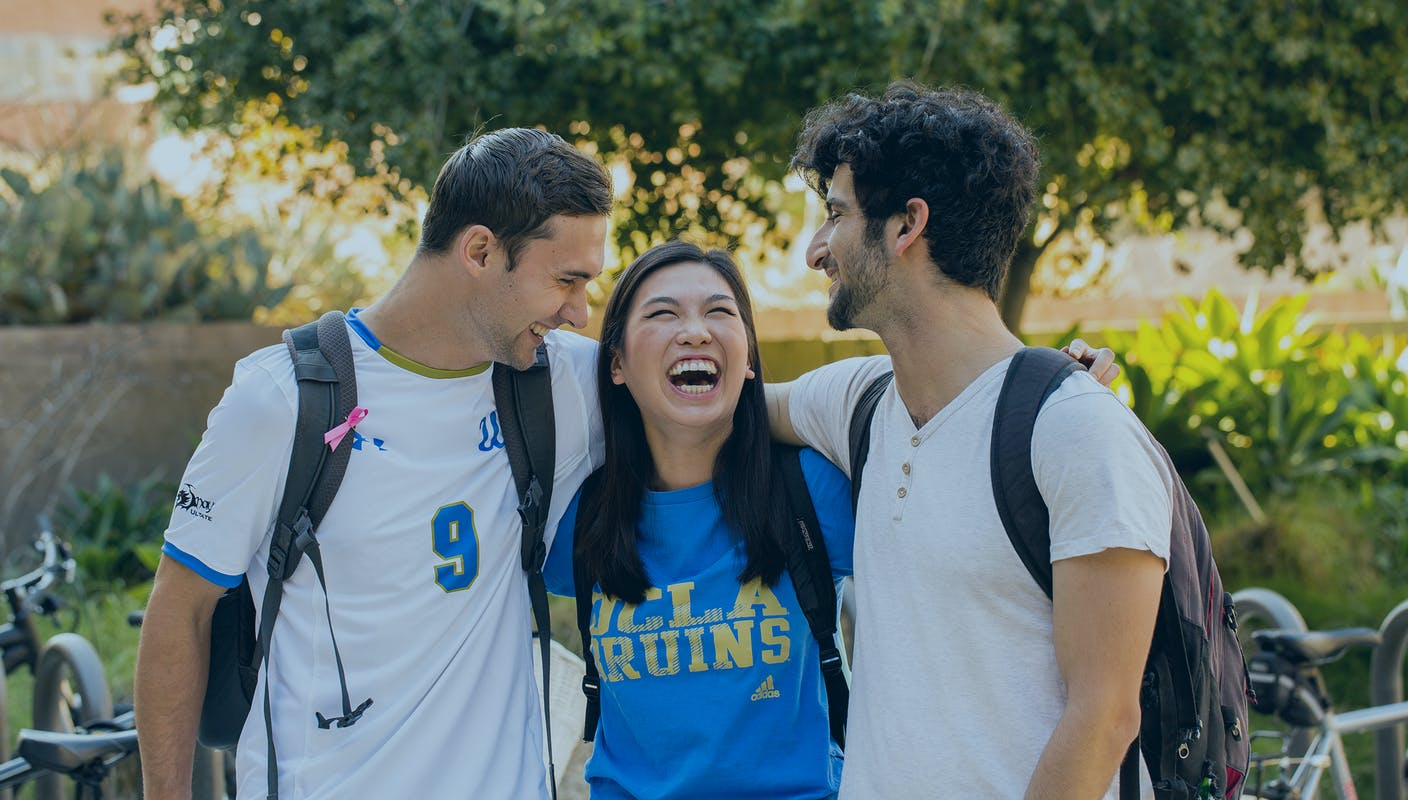 three students laughing