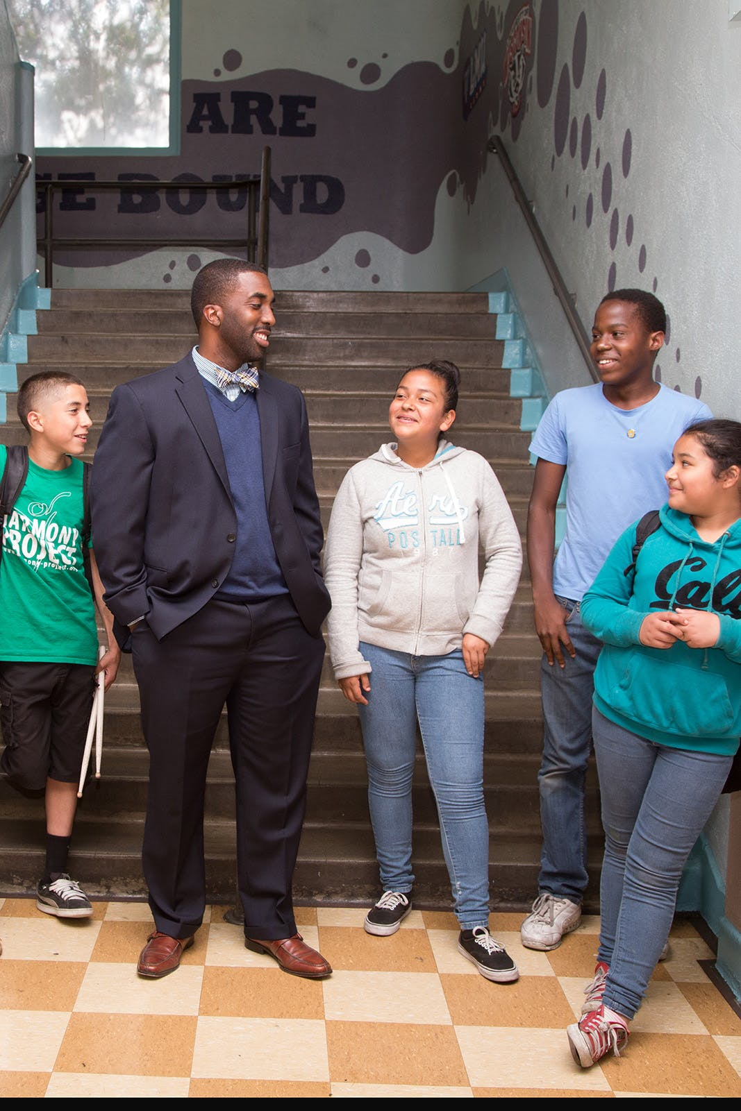 Principal standing in hallway with students