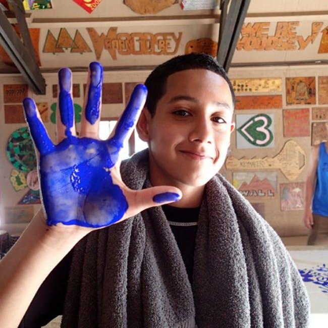 boy holding up his painted hand