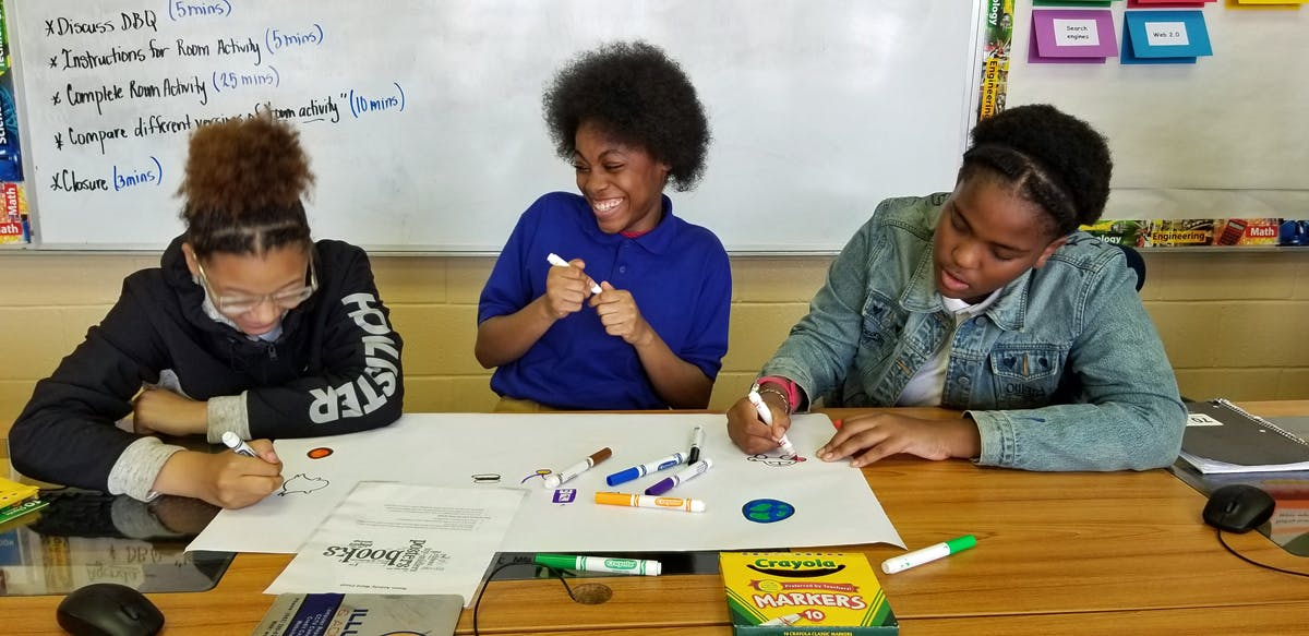 Students in Mississippi sketch out plans for a website.