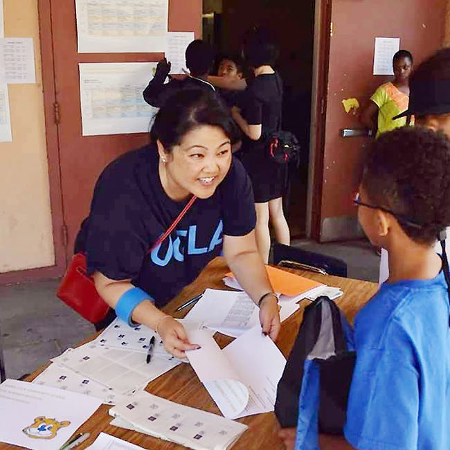 Sarah Bang, former liaison to UCLA Community Schools, welcomed South L.A. students to the Summer Institute at Horace Mann Middle School earlier this year. Photo by Christine Shen